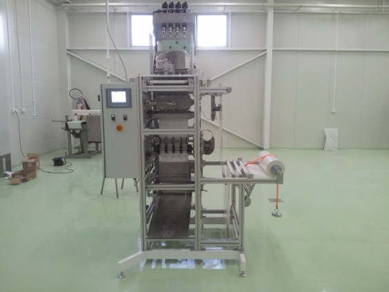Packaging machines for small-sized powdered products in sachet packs